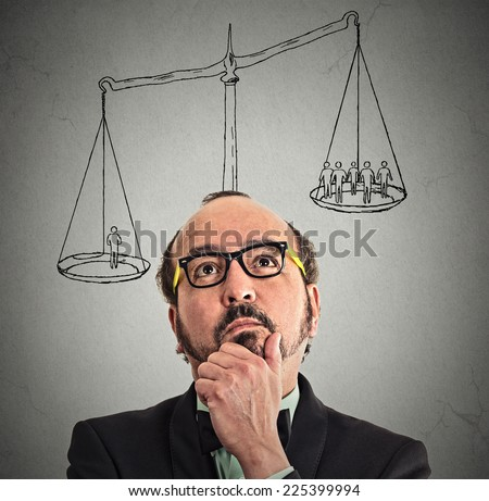 businessman with scale above head one man weighting more than group off business people on a balance. Power, opinion, leadership, self importance, ego concept. Thoughtful face expression, emotion  - stock photo