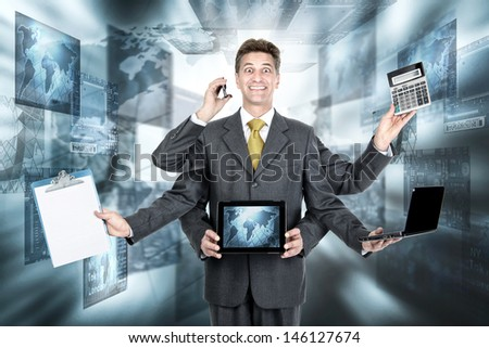Businessman with several arms with different gadgets - stock photo