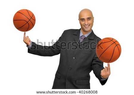 Businessman with several basketballs isolated in white - stock photo