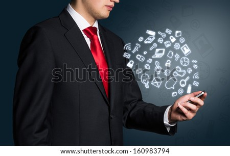 Businessman with smart phone - stock photo