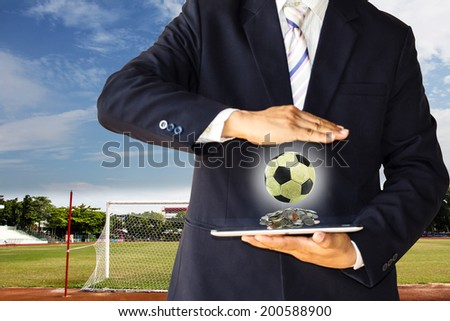 Businessman with soccer ball - stock photo