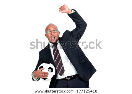 Businessman with soccer ball celebrating a goal, isolated in white - stock photo