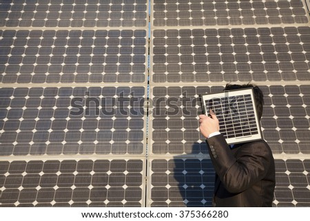 Businessman with solar panels