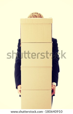 Businessman with stacked Boxes,isolated on white  - stock photo
