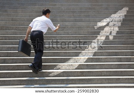 Businessman with stair in business graph concept - stock photo