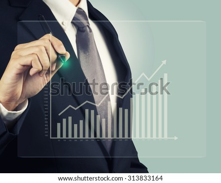 Businessman with stock investment graph take profit - stock photo