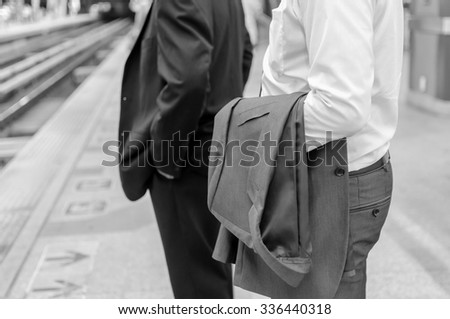 businessman with suit at train station - black and white tone