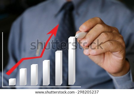 businessman with suit write stock chart trend up,businessman hand pushing a business graph on a touch screen interface, business news background, hardworking good result., management.