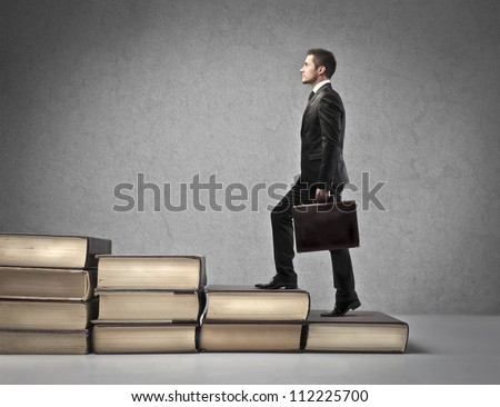 Businessman with suitcase walking the scale - stock photo