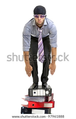 Businessman with swimming gear ready to dive - stock photo