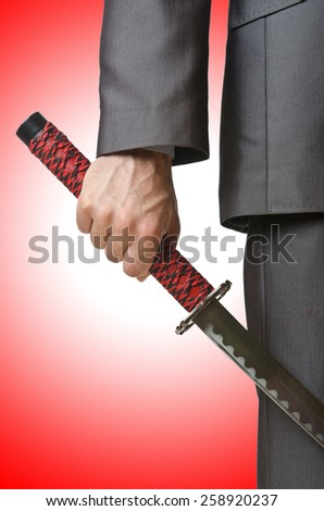 Businessman with sword on white