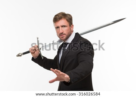 Businessman with sword showing his palm isolated on white background. Serious man in business suit going to stop corruption in his company.