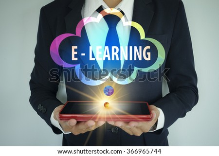 businessman with tablet and cloud E LEARNING text ,cloud computing concept, business concept , business idea - stock photo