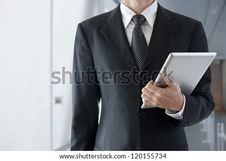 Businessman with tablet computer - stock photo