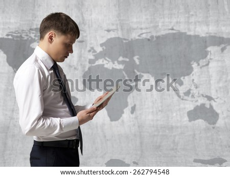 Businessman with tablet computer in office - stock photo