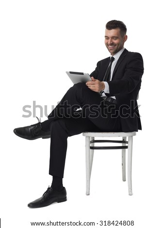 Businessman with tablet computer portrait isolated on white background  - stock photo