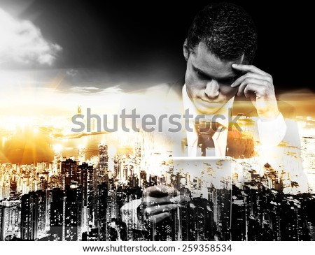 Businessman with tablet pc and modern megapolis  - stock photo