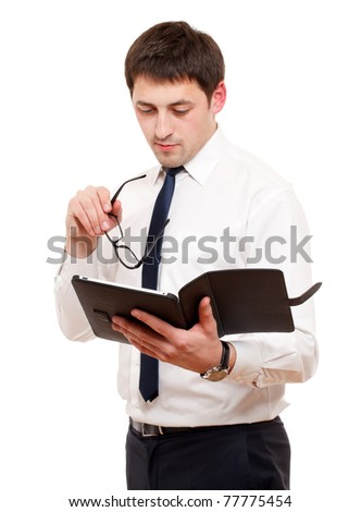 Businessman  with tablet pc. Isolated over white. Focused on hand with reader.