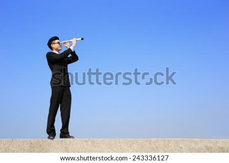 Businessman with telescope ( spyglass ) looking forward Prospects for future business with blue sky background, asian