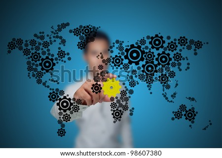 Businessman with the gears that drive the economy. - stock photo