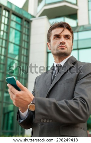 businessman with the smartphone on the street
