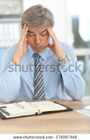 Businessman with tired expression on his face