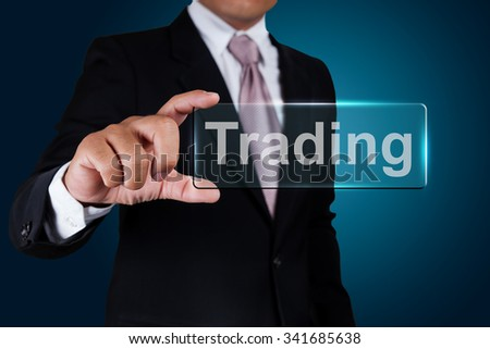 Businessman with trading text label. - stock photo