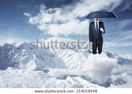 businessman with umbrella and mountain - stock photo