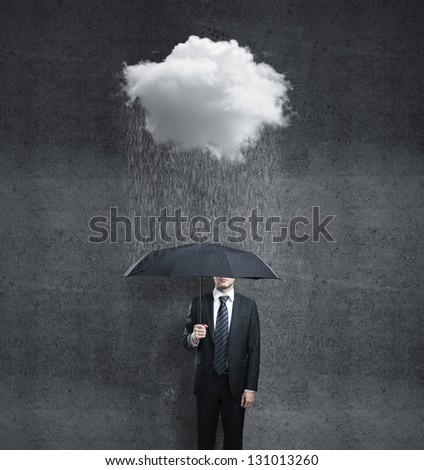 businessman with umbrella and rain