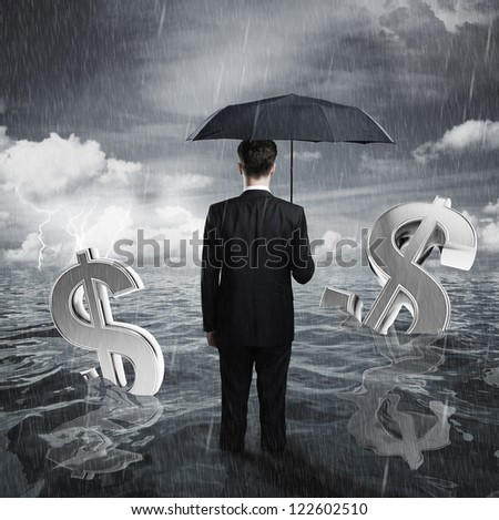 businessman with umbrella business concept - stock photo