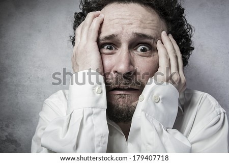 businessman with very afraid, man in white shirt with funny expressions - stock photo