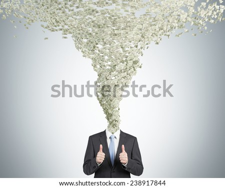 businessman with whirlwind of money  head - stock photo