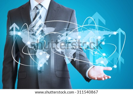 Businessman with world map model on abstract blue background