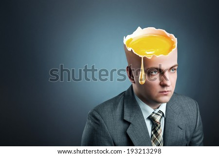 Businessman with  yellow egg istead of head - stock photo