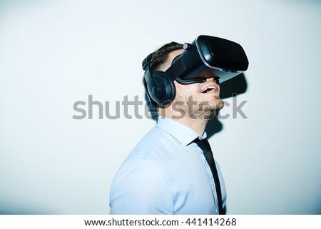 Businessman wondering opportunities of vr simulator - stock photo