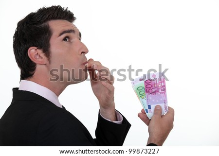 Businessman wondering what to do with his money