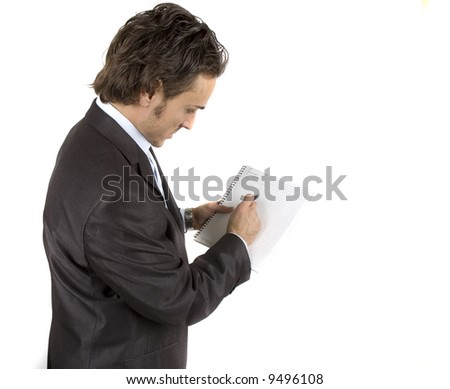 businessman working and writing on his notepad