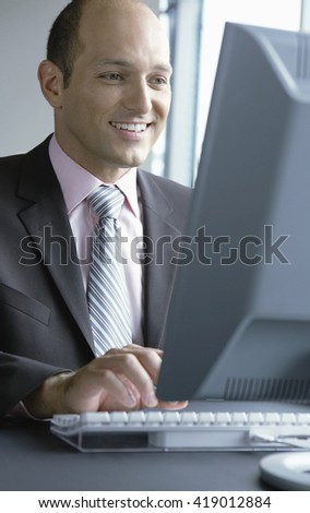 Businessman working at computer in the office