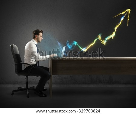 Businessman working at computer with light arrow - stock photo