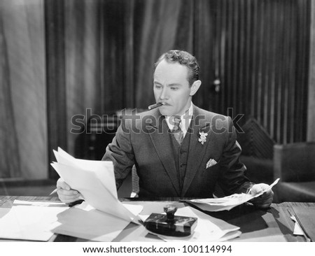 Businessman working at desk - stock photo