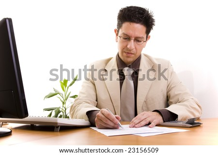 businessman working at his office signing some contracts