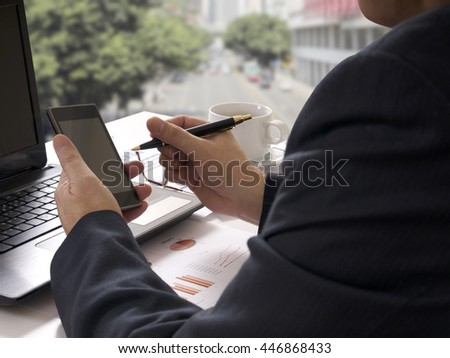 businessman working business with notebook and cellphone on white desk