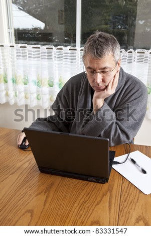 Businessman working from home in pajamas (WINTER) - stock photo