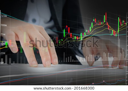 Businessman working hard on stock background