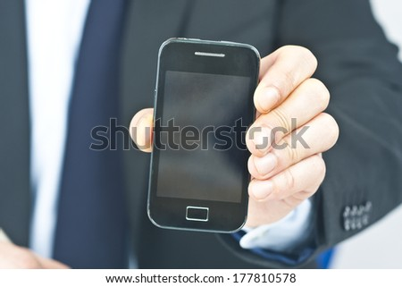 Businessman working in the office with mobile phone