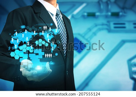 Businessman working mobile phones with new digital modern computer show social network structure - stock photo
