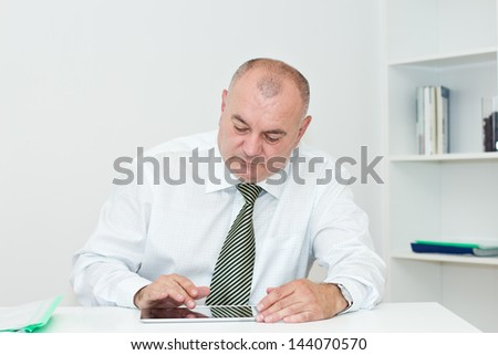 Businessman  working on a Digital tablet in the office. - stock photo