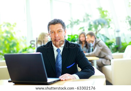 Businessman working on a laptop - stock photo