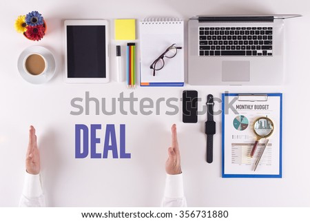 Businessman working on desk - hands showing DEAL concept - stock photo