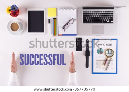 Businessman working on desk - hands showing SUCCESSFUL concept - stock photo